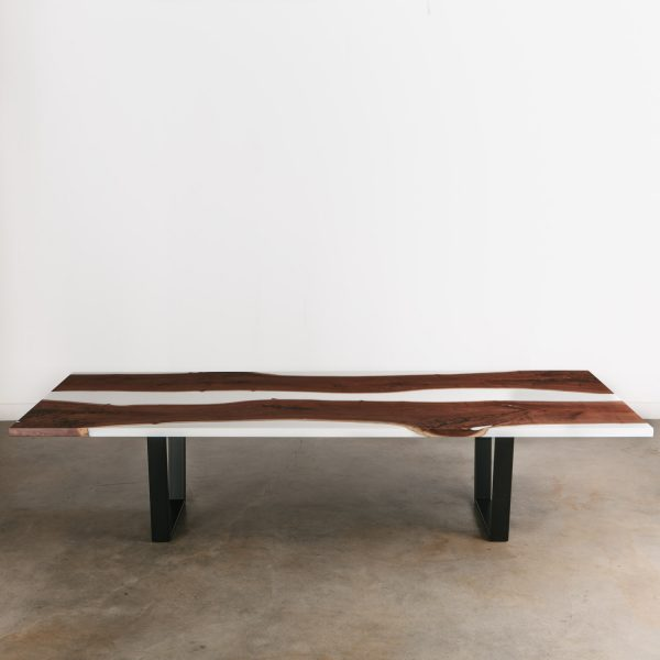 Luxury walnut dining room table with white resin river and black steel base