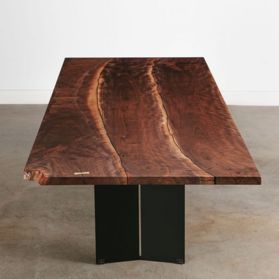 Luxury multi slab walnut dining room table with brass butterfly key accent and gapped design