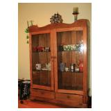 wooden antique cabinet with glass doors
