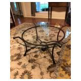 Glass-topped bronze metal coffee table $100