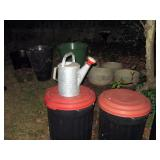 Outside Back yard   Watering can, garbage cans, Large Planters
