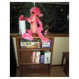 Basement:  Stuffed Pink Panther, Shelf unit, Games