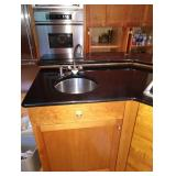 Kitchen: Granite Counter, Cherry Wood Cabinets, Gas Stove Top, Stainless Sink
