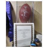 Living Room:  Barry Sanders Autographed Football