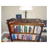 TV Room:  Wood Book Case, Books--Running, Scuba Diving, Hiking, Camping