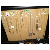 Living Room:  Costume Jewelry Necklesses (No Gold)