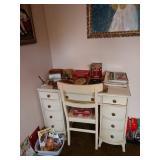 2nd Bedroom Left:   White Desk, Art Books, etc