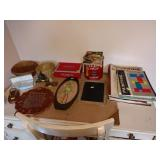 2nd Bedroom Left:   Art Books, Blue Garder in Box,