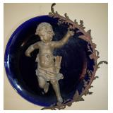 cobalt blue charger with spelter sculpture