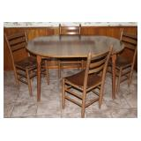 """Vintage maple Formica topped round table with Leaf 42"""" x 52"""" shown with ladder back slat bottom chai"""