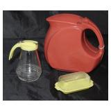Wata-Kanta Depression Era Art Deco Terracotta Red Plastic Pitcher Shown with Vintage Yellow Plastic