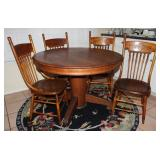 "Antique Oak  48""  Round Pedestal Table and 4 Antique Oak Spindle/Press Back Rabbit Ear Chairs. Shown"