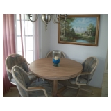 TABLE & 4 CASTOR CHAIRS