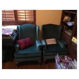 2 green arm chairs