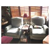 2 light green recliners