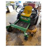 JOHNDEERE 0 turn mower (leaks oil)
