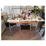 Mid Century Chrome and Laminate Pull-out table with Chrome & wicker chairs