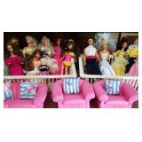 Lots of Barbie and Ken Dolls