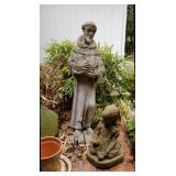 Many outdoor sculptures, pots, and other decor