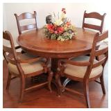 Great round dining table with 4 chairs and extra leaf