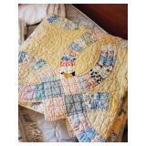 Several vintage handsewn quilts