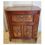 This beautiful  Asian carved cabinet opens up...