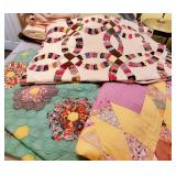 SEVEAL beautiful handsewn quilts