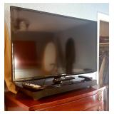 Several large flat screen TV
