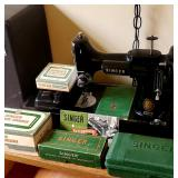 Singer Featherweight sewing machine with original case,  several accessories, original book, etc...