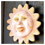 Several terracotta outdoor wall decor pieces (Sun)