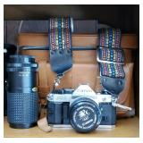 Canon camera with case and lens