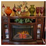 Stunning electric fireplace/ media console with rotating insert that turns around to be a cabinet
