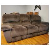 Double recline microfiber sofa with media center middle section.