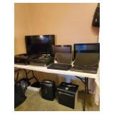 Lots of computers and office equipment