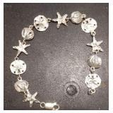 https://www.ebay.com/itm/124156078617RX4152003 STERLING SILVER 925 7 INCH SEA SHELL, SAND DOLLAR, S