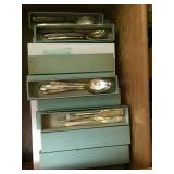 Several sets of flatware.