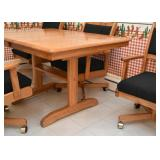 Oak Kitchen Table and Swivel 4 Chairs on Casters (Black Upholstery)