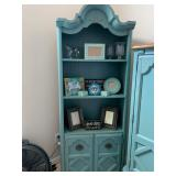 Turquoise painted shelving unit