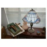 Crucifix and Tiffany-style table lamp
