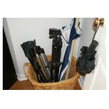 Tripods, umbrellas and wicker basket