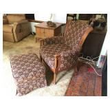 Upholstered Chair with Wood Trim and Matching Ottoman. Ottoman has casters. In Good Condition. Lot N