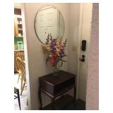 Round Beveled Heavy Hanging Mirror, Small Cherry Wood Table with pull out, Silk Flowers.