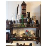 Vases and candle holders on a wall shelf