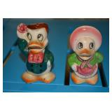 Donald and Daisy Duck - ceramic salt and pepper shakers- marked with Japan on bottom- slight crack (