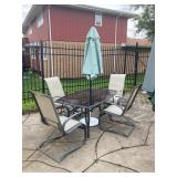 Outdoor table, 4 chairs and umbrella