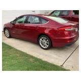 Auction item  2019 Ford Fusion Hybrid,  V6, 44,450 miles, clear of accidents. Top BID IS $19,300