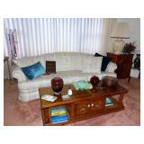 beautiful living room sofa, coffee table, music cabinet, art glass