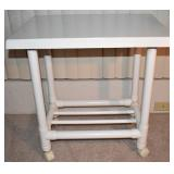 ANOTHER LEISURE WORLD PVC OUTDOOR FURNITURE PIECE. ROLLING SERVE CART OR TABLE