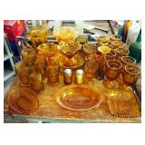 Amber Glass Assortment Including Ruffled Edge Pedestal Bowls, Drinking Glasses, Serving Trays, Salt