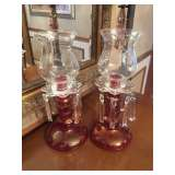 Matching cranberry glass candle holders